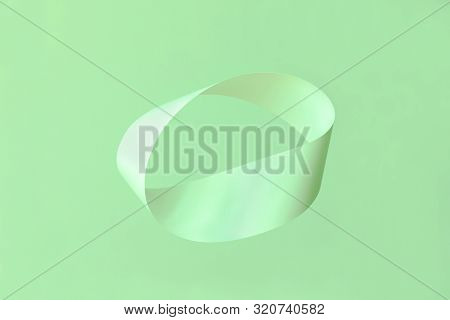 Mobius Strip Soaring In The Air On Mint Background