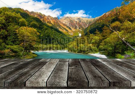 Empty Grey Wooden Table Or Wooden Terrace With Beautiful View Of Kamikochi National Park In The Nort