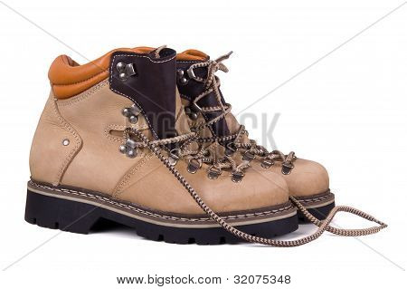 Trekking boots isolated on a white background poster