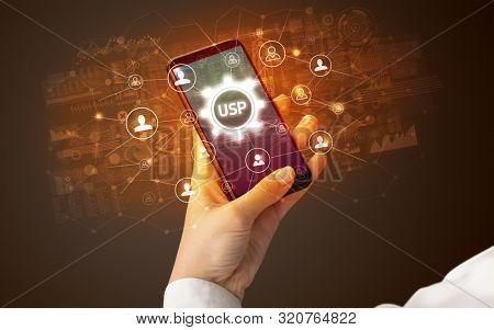 Female hand holding smartphone with USP abbreviation, modern technology concept poster
