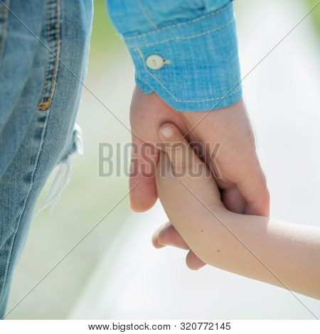 Hands. Father And Son. Parents And Children. Love And Caring. Guardianship. Foster Parents. Adopted