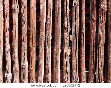 Weathered Dark Brown Wooden Plank And Slat Wall Background, Germany