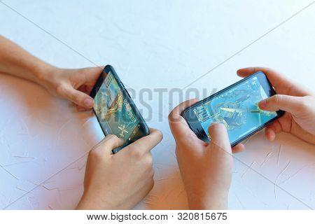 Bishkek, Kyrgyzstan - January 17, 2019: Two Friends Play Pubg Coop Multiplayer Battle Royale Game On