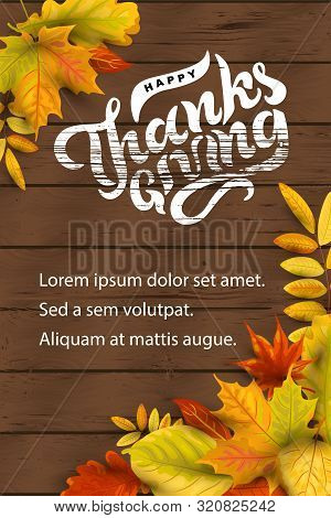 Happy Thanksgiving Hand Drawn Lettering On Dark Wood Background With Falling Leaves. Place For Text.