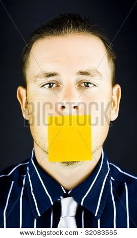 Man With Blank Paper Note Over His Mouth