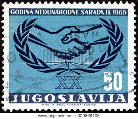 Yugoslavia - Circa 1965: A Stamp Printed In Yugoslavia Shows International Cooperation Year Emblem,
