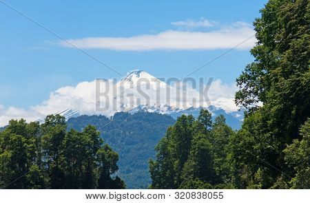 The Snowy Villarrica Volcano In The Distance, From The Pullinque Lagoon, In The Chilean Patagonia, L