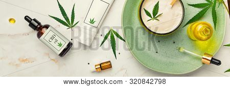 Cosmetics With Cannabis Oil On A Turquoise Plate On A Light Marble Background. Concept Of Luxury Ski