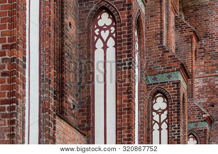 Architectural Elements, Vaults And Windows Of Gothic Cathedral. Red Brick Walls. Kaliningrad, Russia