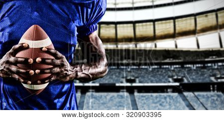 Strong Rugby Player against rugby goal post in a stadium Front view of rugby goal post in a empty stadium