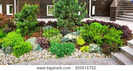 Landscaping Panorama Of Home Garden. Beautiful View Of Landscaped Garden In Backyard. Scenery Of Nat
