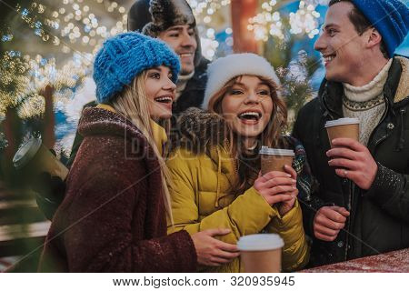 Positive Delighted Best Friends Drinking Hot Beverages