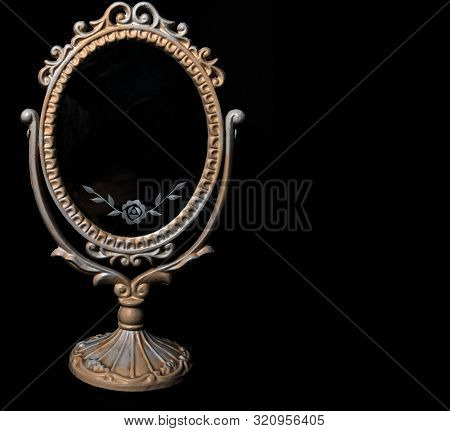 Vintage Oval Desk Mirror With White Yellow Frame On Black Background. White Rose Ornament