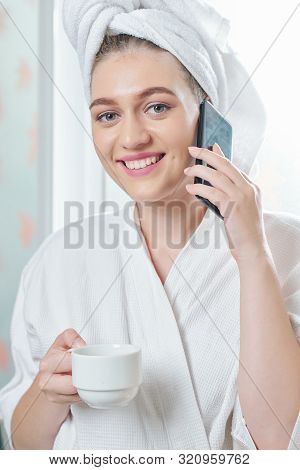 Portrait Of Young Beautiful Female Caucasian Woman With Cup Of Coffee Drinking Morning Coffee And Ta