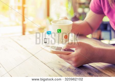 Business Connection Contact Us And Call Center Customer Service Concept. Woman Hand Using Smartphone