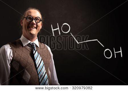 Professor Presenting Handdrawn Chemical Formula Of Ethylene Glycol