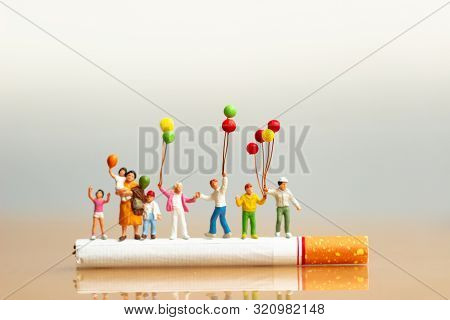 World No Tobacco Day. Cigarette And Family Figure. A Concept For Stop Smoking. Smoking A Cigarette C