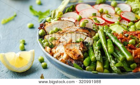Cobb Salad Bowl With Grilled Chicken Breast, Asparagus, Avocado, Radishes And Bacon