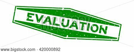 Grunge Green Evaluation Word Hexagon Rubber Seal Stamp On White Background