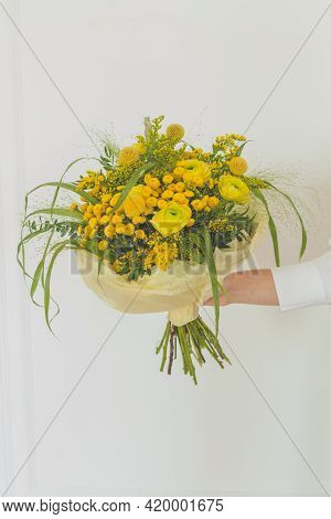 Yellow Flowers And Green Grass Bouquet In Female Hand