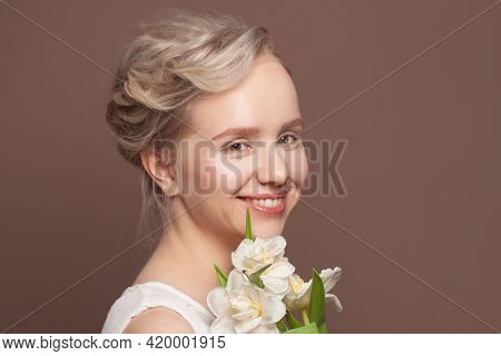 Happy Young Woman With Bridal Wedding Hairstyle And White Flowers On Brown Background