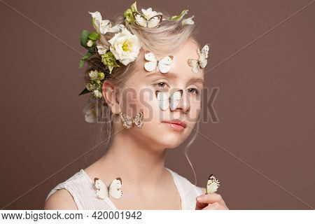 Attractive Young Woman With White Spring Flowers And Butterfly On Brown Background