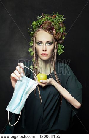 Woman Giving Up Used Medical Face Mask. Environment Protection Concept
