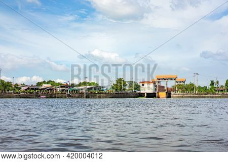 Chao Phraya River In The Open Sky Day With The Village, Temple And Local Building. Shoot It In The B