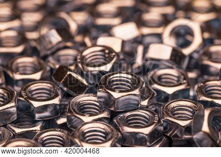Metal Chrome Nuts In A Chaotic Order Industrial Background