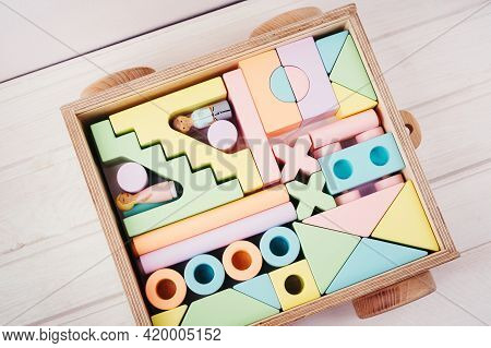 Children's Toys Made Of Natural Material. Wooden Construction Kit In A Large Box-cars Made Of Plywoo