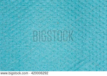 Texture Of The Surface Of Gray Green Unbleached Embossed Disposable Paper Towel, Top View Close-up
