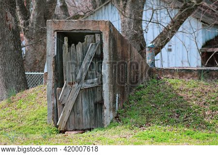 Old Abandoned Rundown Worn Brokendown Storm Shelter Access Door Weathered Over Time As A Rural Land