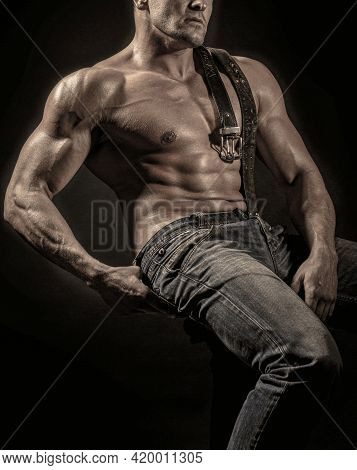 Torso With Six Packs Looks Attractive On Black Background. Leather Belt, Jeans. Torso Six Packs Attr