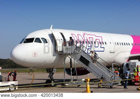 Cologne, Germany - September 22, 2020: Passengers Board Wizzair Airbus A321 Via Stairs At Cologne/bo