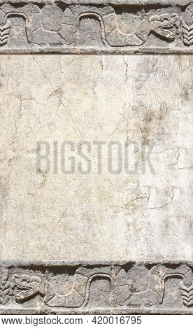 Grunge background with stone wall texture and bas-relief carving of a snake. Vertical banner with copy space for text. Mock up template