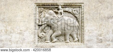 Grunge background with stone texture and bas-relief with elephant rider. Horizontal banner with ancient ornament. Copy space for text. Mock up template