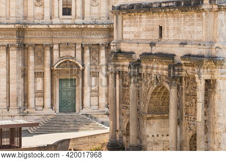 Close-up view of the Arch of Septimius Severus and Santi Luca e Martina church in Rome, Italy.