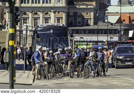 Stockholm, Sweden - July 06, 2017. Group Of People On Bicycles, Cars And Bus Are Waiting For Green T