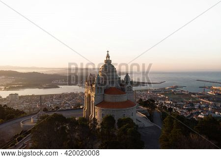 Aerial Sunrise Panorama Of Santuario De Santa Luzia Monastery Sanctuary Hilltop Church In Viana Do C