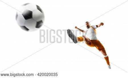 Isolated. Soccer Kick. A Soccer Player Kicks The Ball In Air Fashion. Professional Soccer Player In