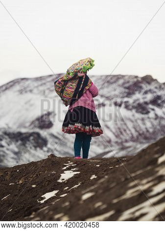 Local Indigenous People In Traditional Colourful Andean Clothes At Vinicunca Rainbow Mountain Near P