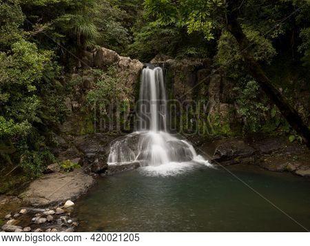 Long Exposure Panorama Of Idyllic Tropical Kauri Tree Forest Waterfall Waiau Falls At 309 Road Corom