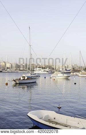 Sailing Yachts Moored At Msida Yacht Marina. Nautical Vessels With Sails At Mediterranean Sea. Water