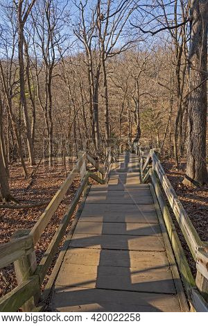 Wooden Stairs Heading Into A Wilderness Canyon In Matthiessen State Park In Illinois
