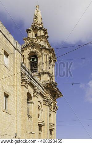 Belltower Of Saint Publius Parish Church Also Known As The Floriana Parish Church On Clear Blue Sky
