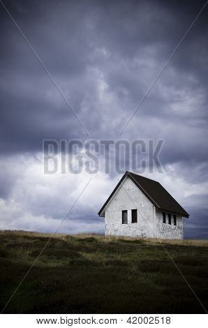 Solitary Abandoned House On A Hill Side