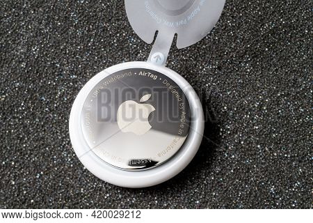 Paris, France - May 2, 2021: Close-up Hero Object Shot Of New Airtag With Mirrror Back Engravings Ul