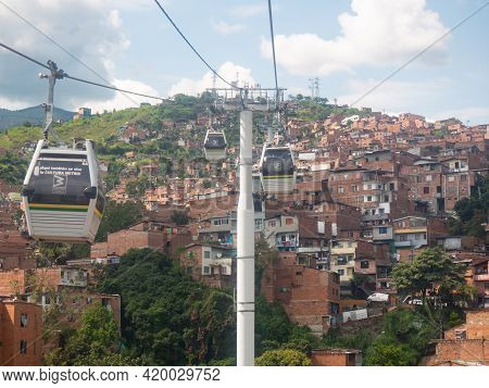 Medellin, Antioquia, Colombia - March 27 2021: The Cable Car Line (metro Cable) On A City Background