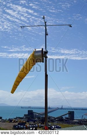 Mackay, Queensland, Australia - May 2021: A Yellow Windsock To Measure Wind Speed And Direction Agai