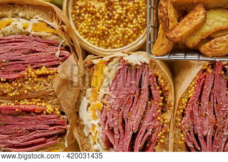 Reuben sandwich. Classic traditional American sandwich. Pastrami and corned beef on grilled bread